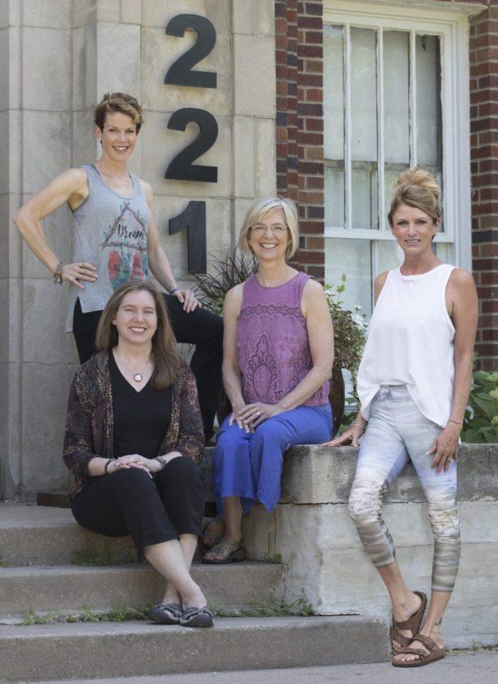 Top left, Devon Olberding, left, Jen Zimmerman Bronder, center, Carol Daly, right, Ann Fleckensteing - Photo by Lisa Lewis from Envisage studios